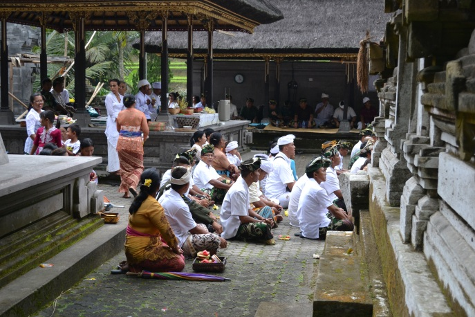 Balinese Hindu attending a ceremony in the monastery of Gunung Kawi in the subak landscape of the Pakerisan watershed.